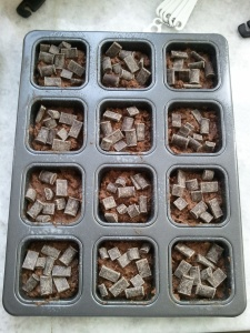 Peppermint brownies - half filled baking pan with chocolate chunks